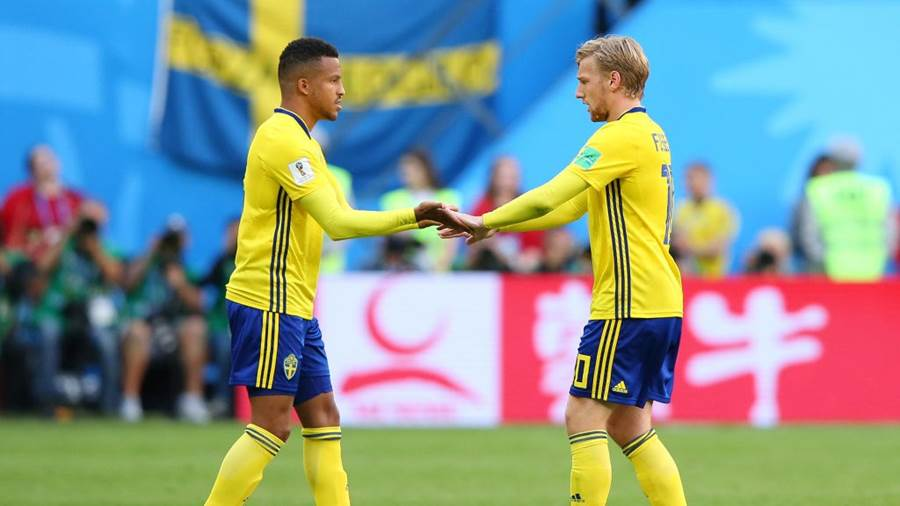 SAINT PETERSBURG, RUSSIA - JULY 03:  Martin Olsson of Sweden greets Emil Forsberg of Sweden as Emil Forsberg is substituted off, and Martin Olsson is substituted on during the 2018 FIFA World Cup Russia Round of 16 match between Sweden and Switzerland at Saint Petersburg Stadium on July 3, 2018 in Saint Petersburg, Russia.  (Photo by Alex Livesey/Getty Images)