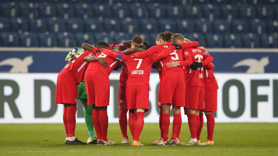 SINSHEIM, GERMANY - DECEMBER 16: RB Leipzig huddle prior to  the Bundesliga match between TSG Hoffenheim and RB Leipzig at PreZero-Arena on December 16, 2020 in Sinsheim, Germany. Sporting stadiums around Germany remain under strict restrictions due to the Coronavirus Pandemic as Government social distancing laws prohibit fans inside venues resulting in games being played behind closed doors. (Photo by Christian Kaspar-Bartke/Getty Images)