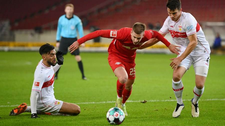 STUTTGART, GERMANY - JANUARY 02: Dani Olmo of RB Leipzig battles for possession with Nicolas Gonzalez and Marc-Oliver Kempf of VfB Stuttgart during the Bundesliga match between VfB Stuttgart and RB Leipzig at Mercedes-Benz Arena on January 02, 2021 in Stuttgart, Germany. Sporting stadiums around Germany remain under strict restrictions due to the Coronavirus Pandemic as Government social distancing laws prohibit fans inside venues resulting in games being played behind closed doors. (Photo by Matthias Hangst/Getty Images)