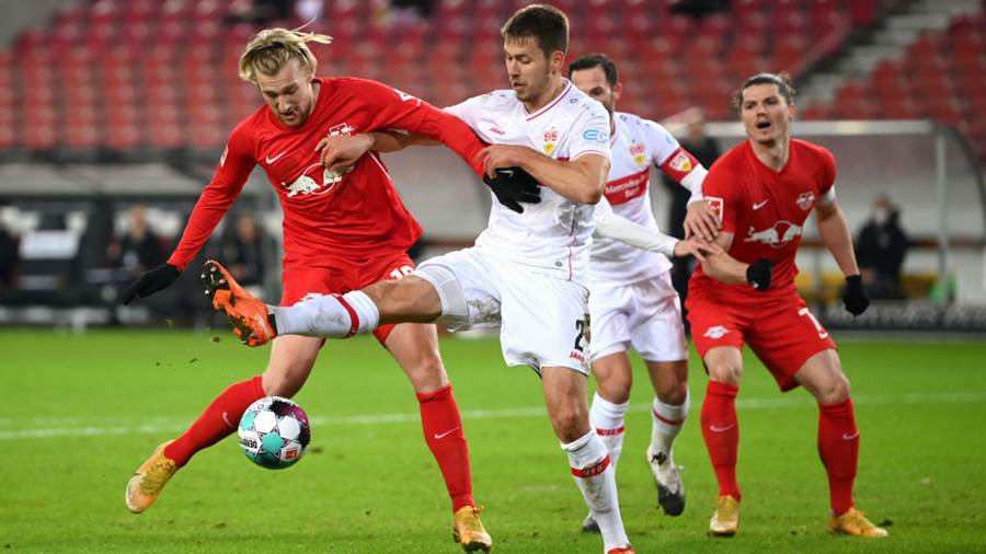 STUTTGART, GERMANY - JANUARY 02: Emil Forsberg of RB Leipzig holds off Waldemar Anton of VfB Stuttgart during the Bundesliga match between VfB Stuttgart and RB Leipzig at Mercedes-Benz Arena on January 02, 2021 in Stuttgart, Germany. Sporting stadiums around Germany remain under strict restrictions due to the Coronavirus Pandemic as Government social distancing laws prohibit fans inside venues resulting in games being played behind closed doors. (Photo by Matthias Hangst/Getty Images)