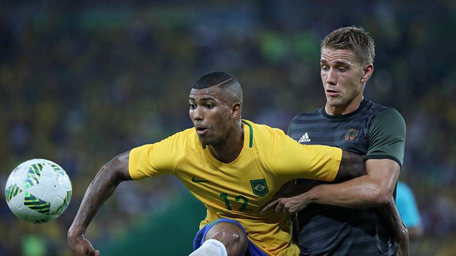 Walace of Brazil and Nils Petersen of Germany vie for the ball during the mens Gold Medal match between Brazil and Germany of the Rio 2016 Olympic Games Soccer tournament.