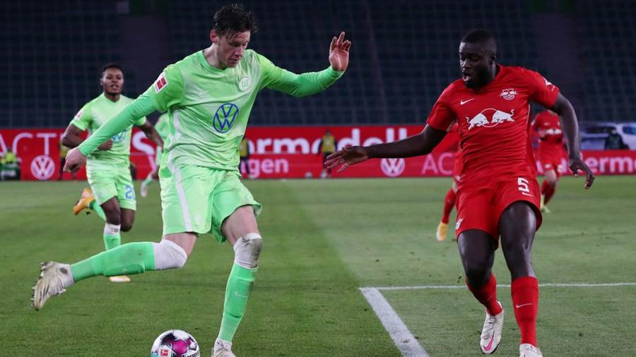 WOLFSBURG, GERMANY - JANUARY 16: Wout Weghorst of VfL Wolfsburg is challenged by Dayot Upamecano of RB Leipzig during the Bundesliga match between VfL Wolfsburg and RB Leipzig at Volkswagen Arena on January 16, 2021 in Wolfsburg, Germany. Sporting stadiums around Germany remain under strict restrictions due to the Coronavirus Pandemic as Government social distancing laws prohibit fans inside venues resulting in games being played behind closed doors. (Photo by Focke Strangmann - Pool/Getty Images)