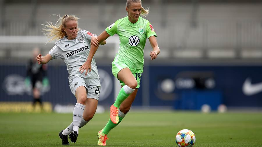 WOLFSBURG, GERMANY - JUNE 28: Fridolina Rolfö (R) of Wolfsburg challenges Barbara Reger of Leverkusen during the Flyeralarm Frauen Bundesliga match between VfL Wolfsburg Women's and Bayer 04 Leverkusen Women's at AOK-Stadion on June 28, 2020 in Wolfsburg, Germany. (Photo by Maja Hitij/Getty Images)